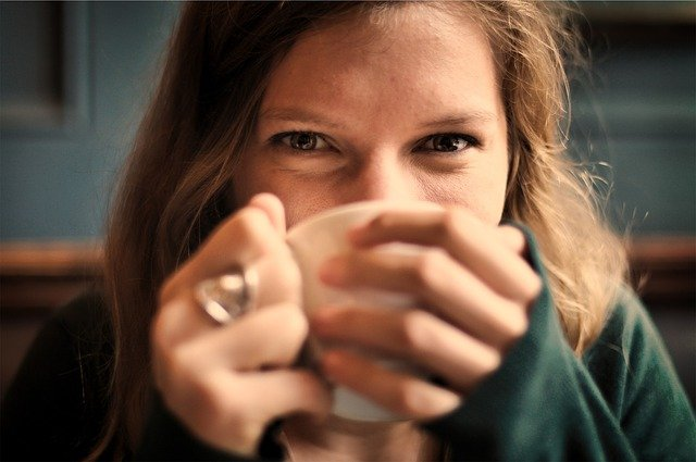 smiling girl drinking coffee.